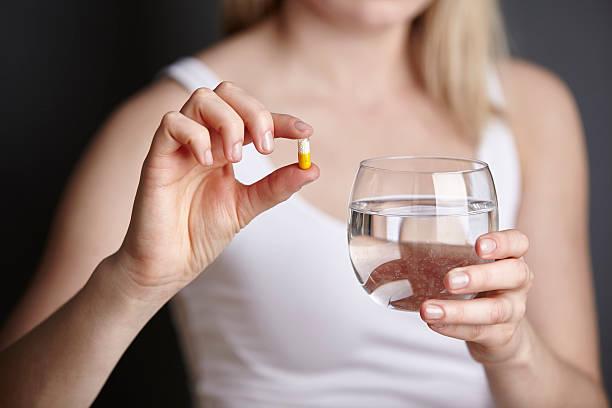 candidiasis medicamento tomar con agua